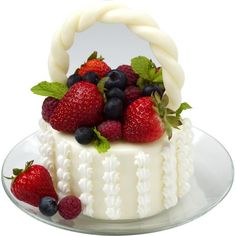 Going Berry Picking Mini Cakes - Single-serve mini cakes will have guests Going Berry Picking. A circle of cake is coated with candy, decorated and topped by a collection of seasonal fruits that adds color and flavor.