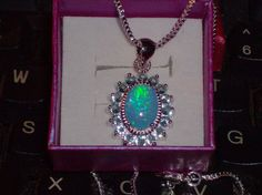 LOOK!!!!! A STUNNING STERLING SILVER BLUE FIRE OPAL AND AQUAMARINE NECKLACE