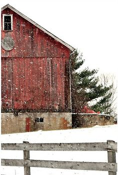 red barn and fence, in the snow.