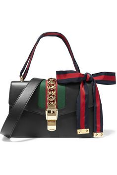 Black leather (Calf), red and green canvas  Flip lock-fastening front flap  Weighs approximately 2.2lbs/ 1kg Made in Italy