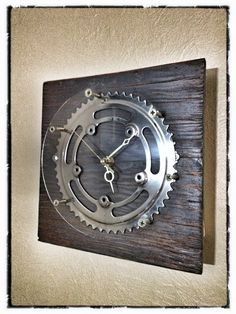 Homemade clock from scrap wood, bike parts, and clock parts