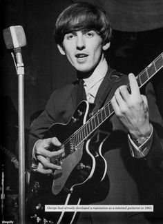 George Harrison Playing Guitar D