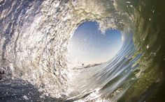 The heart shaped wave snapped in California by Chad Wells. The unique wave wrapped itself around surfer Chad Wells in a touching embrace as he trained on Seal beach in California, US., earlier this year. Despite being totally immersed in the ocean, Chad managed to capture the miraculous moment on camera as it unfolded on the sea's surface.