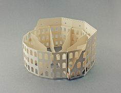 The everlasting durability of the Colosseum is depicted in paper in an attempt to capture its stunning architectural beauty in 3D folds and cutouts.Paper Used: Fedrigoni - betulla 225gr