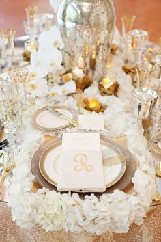 Gorgeous white table with monogrammed napkin. Photo by Perez Photography. www.wedsociety.com #wedding #placesetting