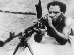 August 1943: A Papuan soldier using a machine gun on a practice range in New Guinea. He is a member of the Papuan infantry operating with allied forces against the Japanese. (Photo by Keystone/Getty Images)