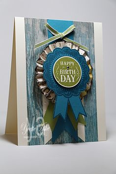 Blue Ribbon Birthday - Masculine birthday card.  Stamps: Blue Ribbon  Paper: Very Vanilla, Island Indigo, Old Olive, Soho Subway DSP  Ink: Island Indigo, Old Olive, VersaMark  Accessories: Perfect Polka Dots Folder, Early Espresso Embossing Powder, 1-3/8″ Circle Punch, Old Olive 1/8″ Taffeta Ribbon, 1/8″ Mini Brad, Stampin' Dimensionals