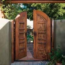 GATES!? Omg! I want a courtyard with gates like this. I have the perfect area and yard for this! LOVE