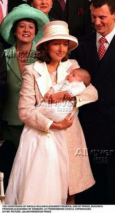 Alexandra Manley, then Princess of Denmark, at the baptism of her elder son Nikolai in 1999. Her sister Nicola Baird (I believe) is a godmother.