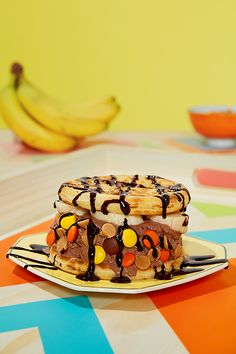 The perfect summer treat for all the Peanut Butter lovers out there. BREYERS® REESE® Peanut Butter Cups® frozen dessert, HERSHEY'S CHIPITS TOPPERS Reese and SMUCKERS® Sundae Syrup™ stacked between EGGO® Waffles. YUM! #wafflewich