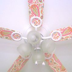 Mod podge your ceiling fan with scrapbook paper!  So fun for a kid's room! This is such a cute and cheap idea!