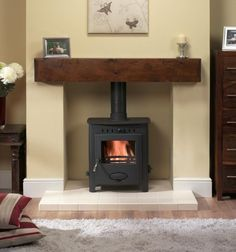 Fireplace Surrounds For Wood Burners. Wood Burner Fireplace, Home Fireplace, Fireplace Surrounds, Fireplaces, Fireplace Ideas, Brick Fireplace, Log Burner Living Room, Home Living Room, Boiler Stoves