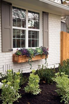 Seriously want a window box like this where I can grow herbs near the kitchen.