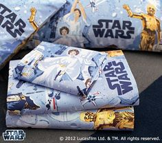 Too bad we only have one of daddy's vintage Star Wars pillowcases. We may have to make a Pottery Barn purchase to get a second...