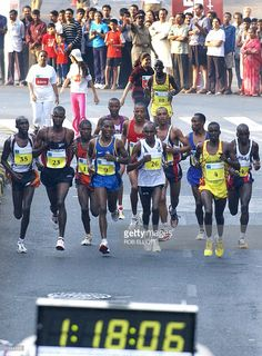 South African marathon runner, Hendrik Ramaala (CBACK red) runs amongst a group of international runners who took the lead at the one hour and eighteen minute mark, prior to winning the 42.2km Bombay International Marathon 2004 in Bombay, 15 February 2004. Some twenty thousand runners participated in the 42km marathon, a 21km half marathon and a 7km dream run running through the streets of India's financial and entertainment capital. AFP PHOTO/Rob ELLIOTT