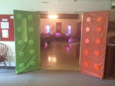 Workshop of Wonders VBS Lego doors. Covered doors with plastic table cloth then used colored plastic plates as bumps.