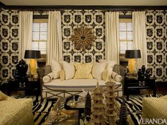 trim and molding black, a large-scale wallpaper with a bold pattern mixed with antiques and collected accessories.