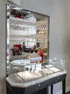 cabinet with glass shelves, cabinets in stainless steel, jewellery table smoked wood, freestanding showcase