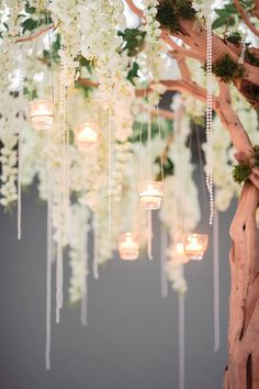 White flowers and hanging tealights | Terry and Guozi's Architecture Inspired Wedding at Flower Field Hall