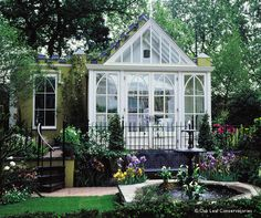 The all glass sunroom is just beautiful! Added is the gorgeous landscaping for a complete, colorful inside-out, outside-in success!