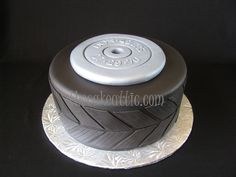Tire and weight plate cake for a man that body-builds and fixes cars. By thecakeattic.com in Salisbury, NC www.facebook.com/thecakeattic