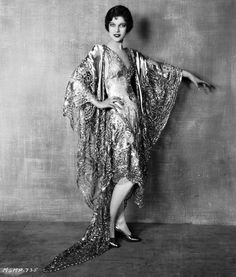 Loretta Young in 1928 wearing a metallic lace evening dress