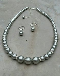Check out this item in my Etsy shop https://www.etsy.com/listing/65241307/swarovski-light-grey-pearl-set