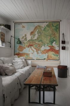 love the size of this map in relation to the white room! awesome coffee table idea too with 2 plank seats...