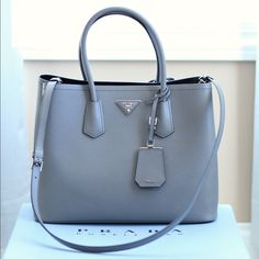 100% authentic Prada Cuir Double Tote This is a medium size authentic Prada double bag in gray (marmo). Sold out everywhere. It's in brand new condition. More info can be found on Neiman's website Prada Bags Totes