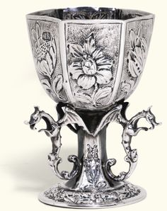 A CONTINENTAL SILVER CUP, MAKER'S MARK IR, PROBABLY DUTCH, 17TH CENTURY hexagonal, embossed with flowers on matting above winged monster bra...