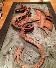 Cardboard relief sculpture dragon