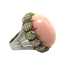 Gold, coral, diamonds- circa 1970- signed Buccellati Italy. This is so deeply fabulous.