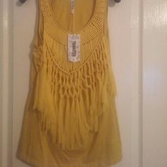 Women's NWT tank top NWT..never worn...Women's tank top with a beautiful fringe design. Monoreno Tops Tank Tops