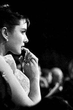 Audrey Hepburn awaiting results for the 'Best Actress' category at the 1954 Academy Awards, which she won.