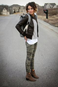 Leather jacket, gray backpack and camo skinnies and ankle boots