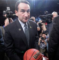 Duke coach Mike Krzyzewski smiles after he was presented with the game ball after Duke defeated Michigan State 74-69 in an NCAA college basketball game, making him the winningest men's basketball coach in Division I, Tuesday, Nov. 15, 2011, in New York.