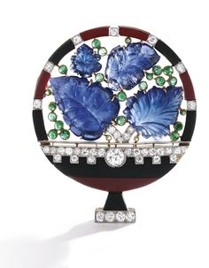 18 Karat Gold, Platinum, Colored Stone and Diamond Brooch, Cartier, France The fanciful flower arrangement set with four carved sapphire leaves accented by 24 cabochon emeralds, within a frame of black and red simulated lacquer, further set with old European and single-cut diamonds , circa 1930