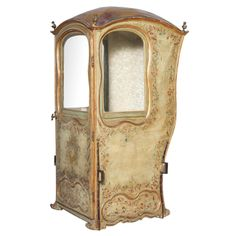 18th C. Venetian Sedan Chair from the Estate of Tiziani Italy 18th Century A rare and unusual sedan chair, its side panels and door covered in leather and free-form mullions decorated by hand-painted florals, domed roof with a gilded finial at each corner.
