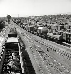 """March 1943. """"Needles, California. A general view of the Atchison, Topeka & Santa Fe rail yard."""" Photo by Jack Delano, Office of War Information. View full size."""