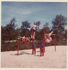 kids in the 60's on horizontal bars