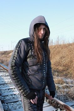 A mens winter jacket with lacing and detachable assassins mask.  Fully handcrafted. One of a kind; the only one in the world like it. As unique as you!!! Made from wool and eco leather & polyester lining.  Chest: up to 105 cm (43) Length: 75 cm (29,5)  FREE SHIPPING WORLDWIDE
