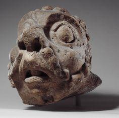 Head of a Grotesque, ca. 1200–1220, France, Champagne, Châlons-sur-Marne, Church of Notre-Dame-en-Vaux (?), Limestone, 35.6cm | The Metropolitan Museum of Art