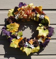 Orange Purple Rustic Golden Autumn Fall grapevine wreath filled with east texas pinecones and oversized artificial leaves