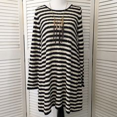 HP Free People Counting Stripes tunic / dress So cozy and cute. Mid weight slubby knit in black and ecru stripes. Long sleeves, scoop neck. Flattering swing silhouette. Sexy low-cut V back. Wear as a dress or a tunic! NWT; never worn. Free People Dresses Long Sleeve