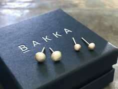 Massive earstuds made of recycled gold Norwegian jewelrydesign by BAKKA