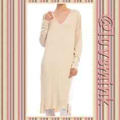 V NECK CASUAL TUNIC KNIT DRESS IN IVORY - M/L Comfy, V neck, long knit dress feels like a soft lightweight fleece against your skin.  Ribbed around neck and bottom to finish. Two great colors available: Ivory and Charcoal. 55/45 Cotton/Rayon, Length is 47 inches.  Great to belt, or layer. Wear over boots for a very chic look. Sized S/M and M/L, limited quantities. NO HOLDS/TRADES. Price is FIRM, unless bundled.  This listing is for a M/L in Ivory debut Dresses