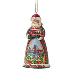 Enesco Jim Shore Heartwood Creek San Francisco Santa Ornament, 4-1/2-Inch Enesco,http://www.amazon.com/dp/B0085NVXS2/ref=cm_sw_r_pi_dp_OrrEsb1SD76DWNRT