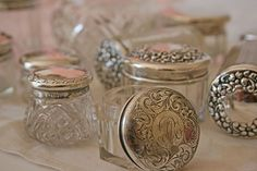 Silver and glass vanity jars.