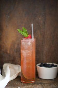 Strawberry Mojito 3 oz light rum | 1 oz simple syrup | 1/2 oz lime juice | 3 muddled strawberries | 4-5 mint leaves | Club soda