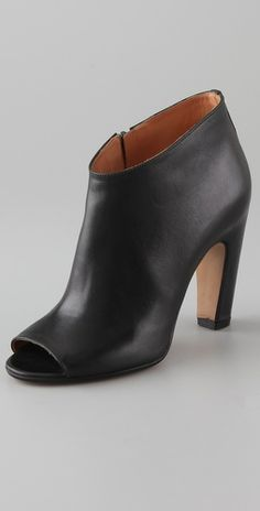 Maison Martin Margiela  Open Toe High Heel Booties- Want these for my go-to spring shoe.  I would wear them with boyfriend jeans, rolled up just past the ankle and a deep v-neck white t-shirt.  Some brite lipstick or clutch nand I am all set for brunch!